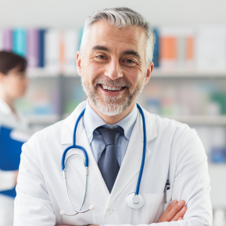 a smiling male physician in a healthcare setting - physician marketing strategies